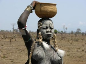 Mursi tribe young woman in Mago National Park, Omo Valley, South Ethiopia