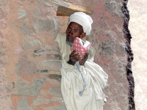 priest in Lalibela in rock hewn churches, Ethiopia