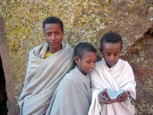 young boys in rock hewn church around Lalibela, North Ethiopia