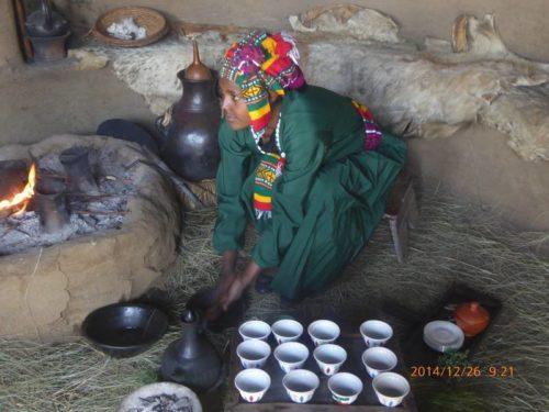Woman executing coffee ceremony, Ethiopia