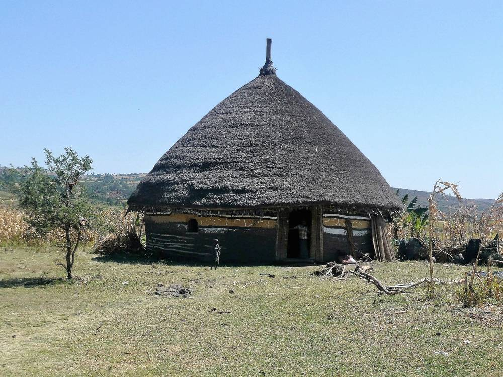 Painting house in Halaba village, Rift Valley, South Ethiopia
