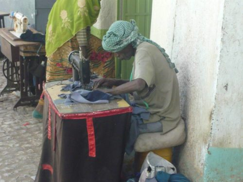 Man at sewing machine in old city of Harar, East Ethiopia